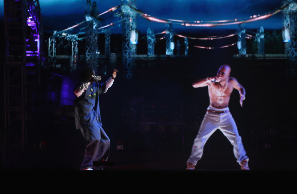 Rapper Snoop Dogg (L) and a hologram of deceased Tupac Shakur perform onstage during day 3 of the 2012 Coachella Valley Music & Arts Festival at the Empire Polo Field on April 15, 2012 in Indio, California.