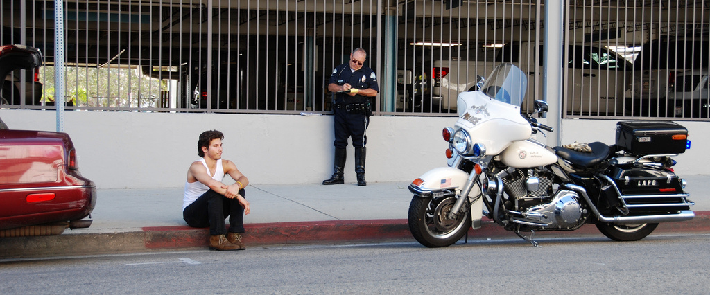 An unidentified police officer writes a ticket on N. Cahuenga Blvd. in Hollywood, CA.