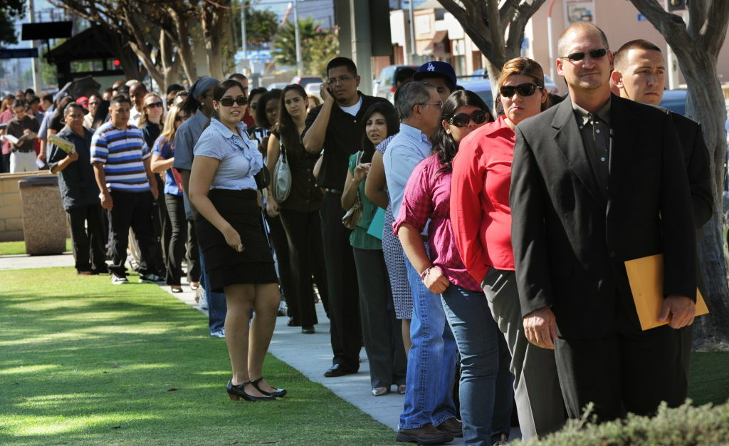 Unemployed Americans line up to enter a job fair in El Monte. The number of people seeking unemployment aid barely changed last week and the average over the past month fell to a fresh five-year low. A decline in layoffs is helping strengthen the job market.The Labor Department says weekly unemployment benefit applications rose just 2,000 to a seasonally adjusted 336,000.  AFP PHOTO/Mark RALSTON (Photo credit should read MARK RALSTON/AFP/Getty Images)