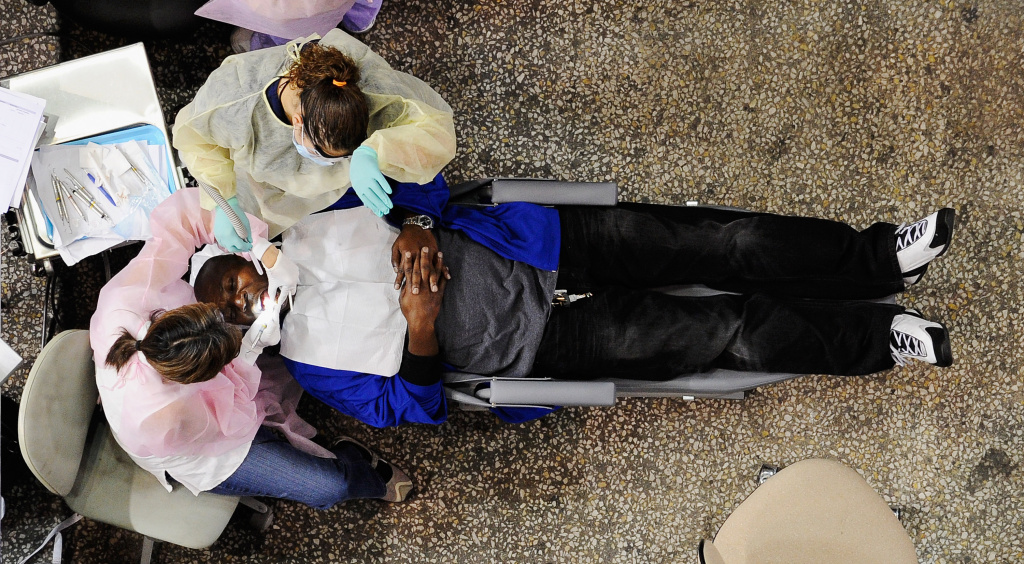 A patient receives dental care at the 2011 Care Harbor clinic in South Los Angeles. At the 2012 event, Care Harbor's CEO said dental care was by far the biggest need there.