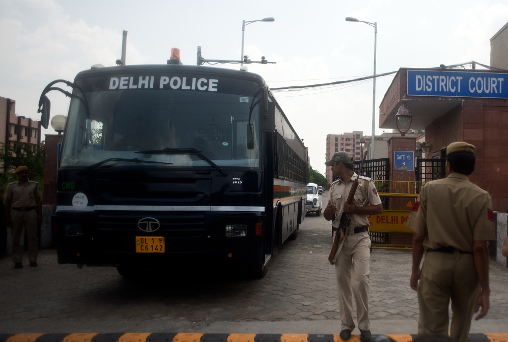 An Indian police vehicle believed to be carrying the accused in a gang rape and murder case, leaves the Saket District Court, following the verdict in New Delhi on September 10, 2013. An Indian court convicted four men of the gang rape and murder of a physiotherapy student on board a moving bus in a crime that sickened the nation.