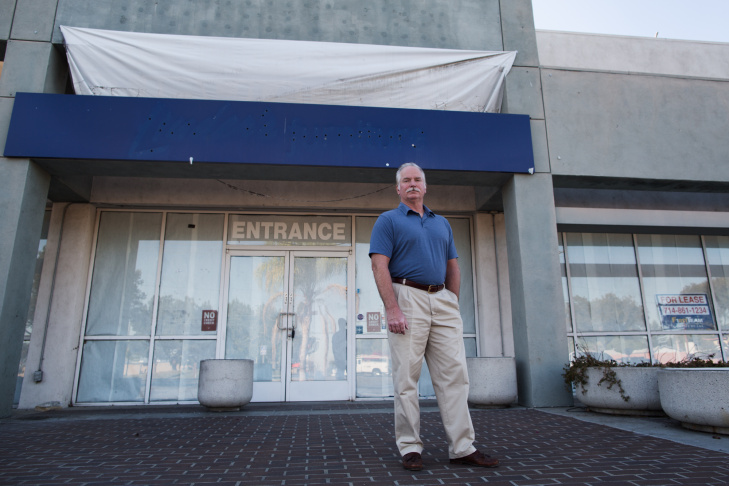 Ron Thomas, father of beating victim Kelly Thomas, stands outside a former furniture store in Fullerton, Calif.,  that he had hoped would become a homeless shelter in Orange County.