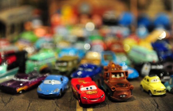 A collection of Mattel die-cast vehicles from the Disney-Pixar film 'Cars' are displayed at an exhibition in Los Angeles