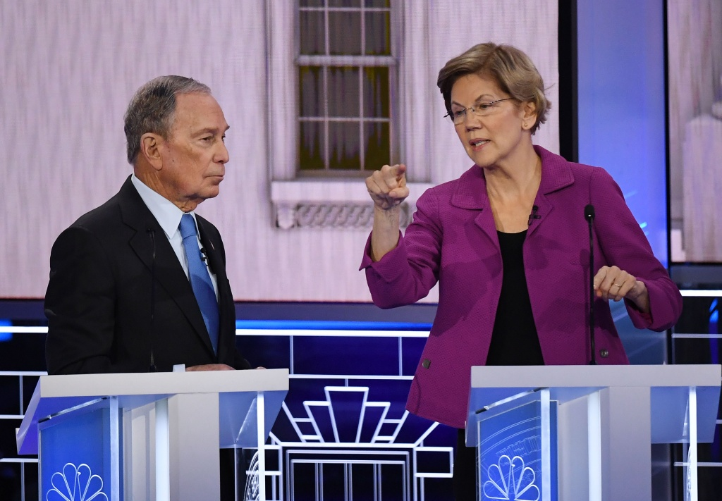 Democratic presidential hopefuls Former New York Mayor Mike Bloomberg and Massachusetts Senator Elizabeth Warren speak during a break in the ninth Democratic primary debate of the 2020 presidential campaign season co-hosted by NBC News, MSNBC, Noticias Telemundo and The Nevada Independent at the Paris Theater in Las Vegas, Nevada, on February 19, 2020.