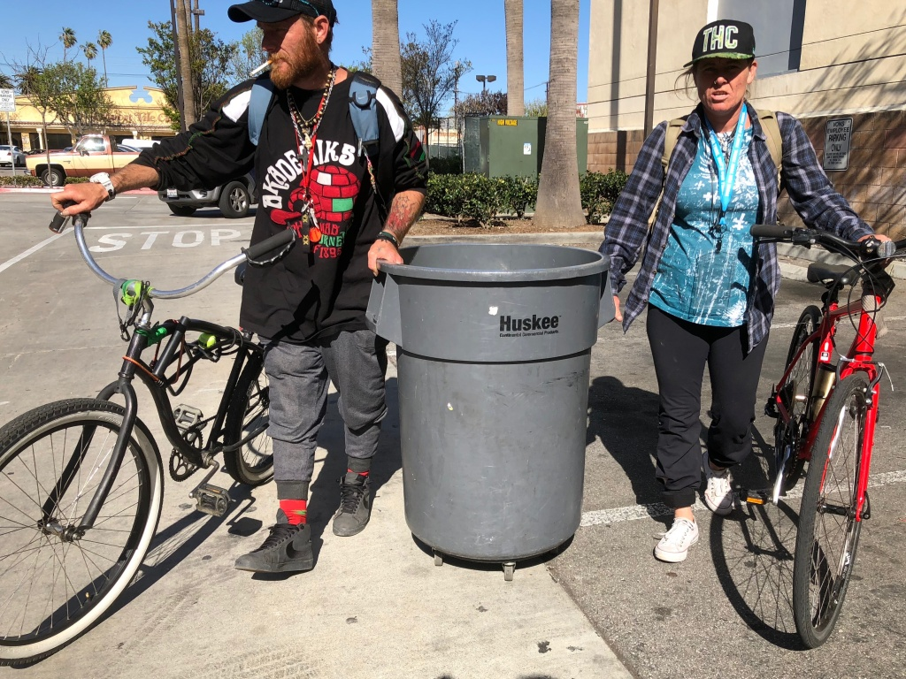 Robbin Nugent was asked to leave a Santa Monica shelter for not utilizing her bed enough, so she packed her belongings into a rolling trash can. Nugent is pregnant with twins.