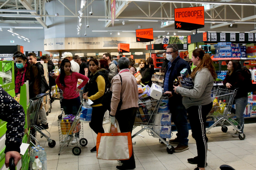 People wear face masks while shopping in a supermarket on March 14, 2020 in Athens, Greece.