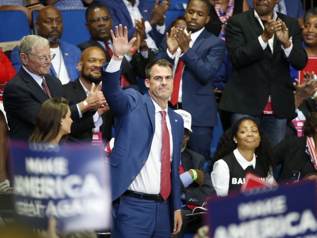 Oklahoma Gov. Kevin Stitt attends President Trump's campaign rally last month in Tulsa. Stitt dismisses the notion that he became infected at the June 20 event, saying it was too long ago.