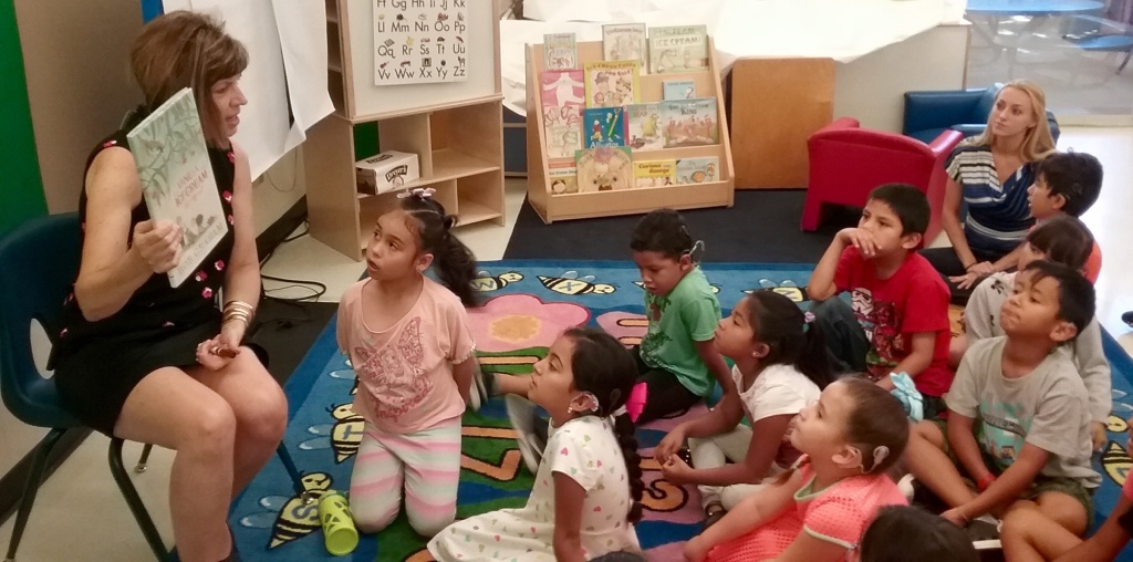 Debra Schrader reads with children in USC's Come Read with Me program for English learners who are deaf or hard of hearing.