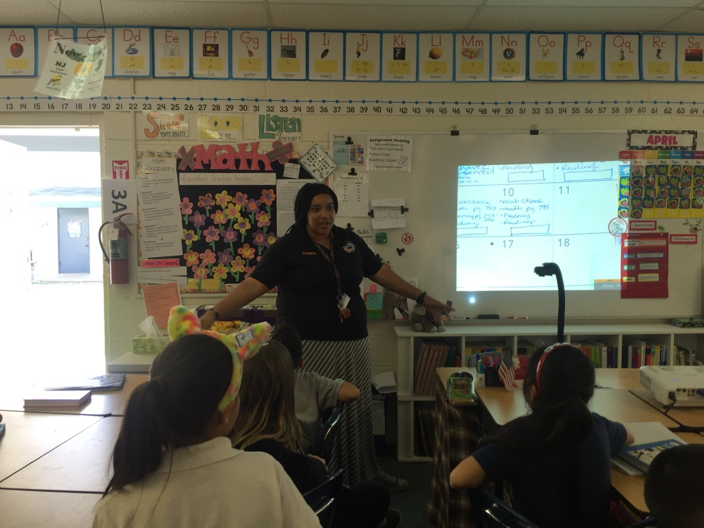 Magnolia Science Academy 7 third grade teacher Jennifer Rivera reminds students of the upcoming talent show before dismissing her class for the day.