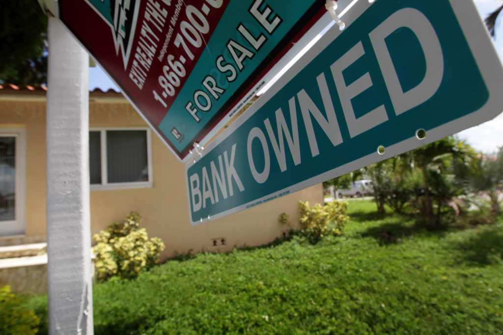 The housing crisis continues, as government searches for new solutions. A Bank Owned sign is seen in front of a foreclosed home on September 16, 2010 in Miami, Florida.