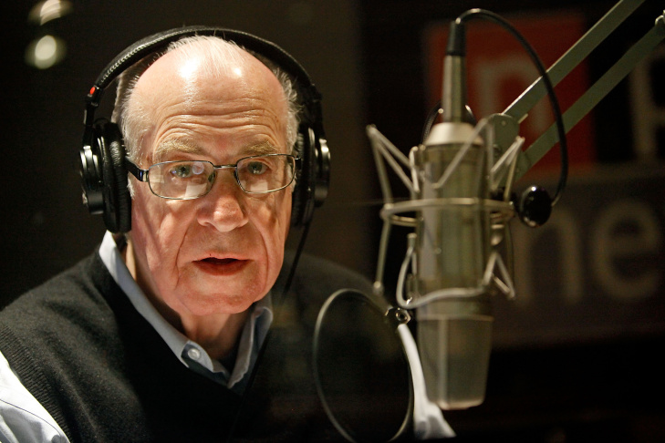 National Public Radio's Carl Kasell puts on his headphones before delivering one of his last newscasts during the Morning Edition program at NPR December 30, 2009 in Washington, DC. Kasell continued his work on the game show