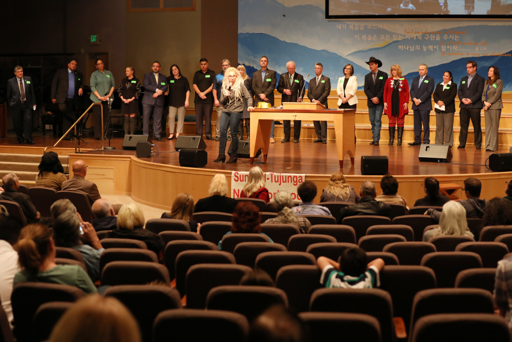 Dana Stangel, vice president of outreach for the Sunland-Tujunga Neighborhood Council, introduces the candidates at a forum for Los Angeles City Council District 7 at All Nations Church in Lake View Terrace on Feb. 11, 2017.