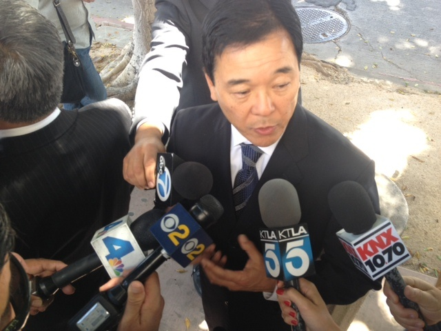 LA sheriff's candidate Paul Tanaka answers questions after testifying in a deputy misconduct trial in federal court.