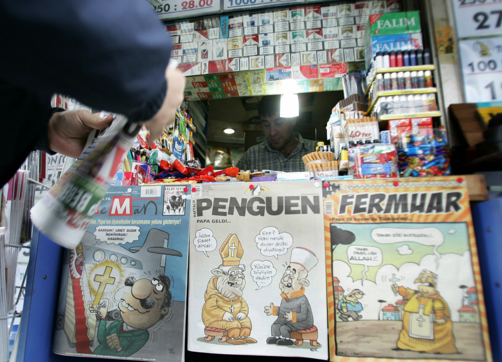 A vendor displays satirical magazines showing Pope Benedict XVI, near the Sultanahmet district in Istanbul 29 November 2006.