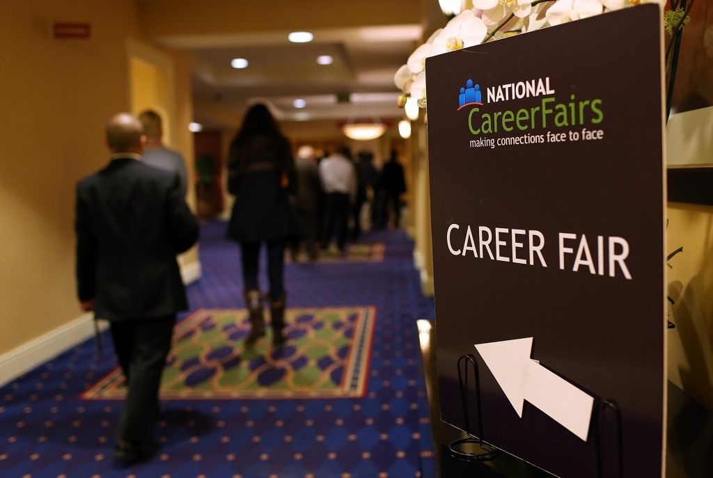 Job seekers arrive at a San Francisco South Career Fair last summer. The U.S. Labor Department said Thursday the average number of people seeking unemployment benefits over the past month fell to the lowest level since March 2008, a sign that the job market is healing.
