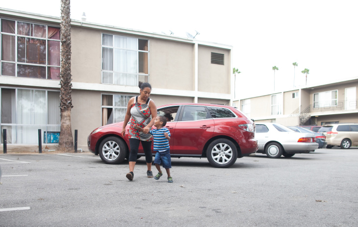 Delroy Haughton, 4, plays on the carpet at his home in South Los Angeles. Delroy has asthma and his symptoms were made worse by the living conditions of his family's apartment, said his mother, Emily Zelaya.