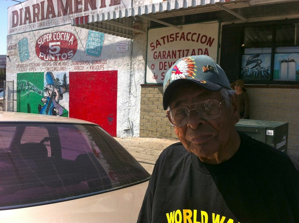 Albert Morales standing in front of a little store kind of like the one his neighbors, a Japanese family. owned.