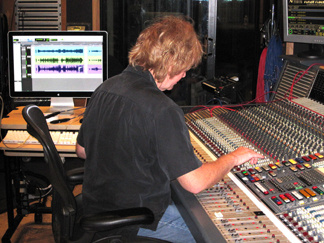 Charlie Paakkari works with a mixing board at Capitol Records' studios.