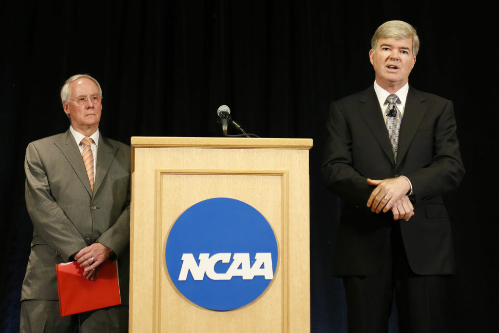 NCAA president Mark Emmert (R) speaks as Ed Ray, chairman of the NCAA's executive committee and Oregon State president looks on, during a press conference at the NCAA's headquarters to announce sanctions against Penn State University's football program in Indianapolis, Indiana.