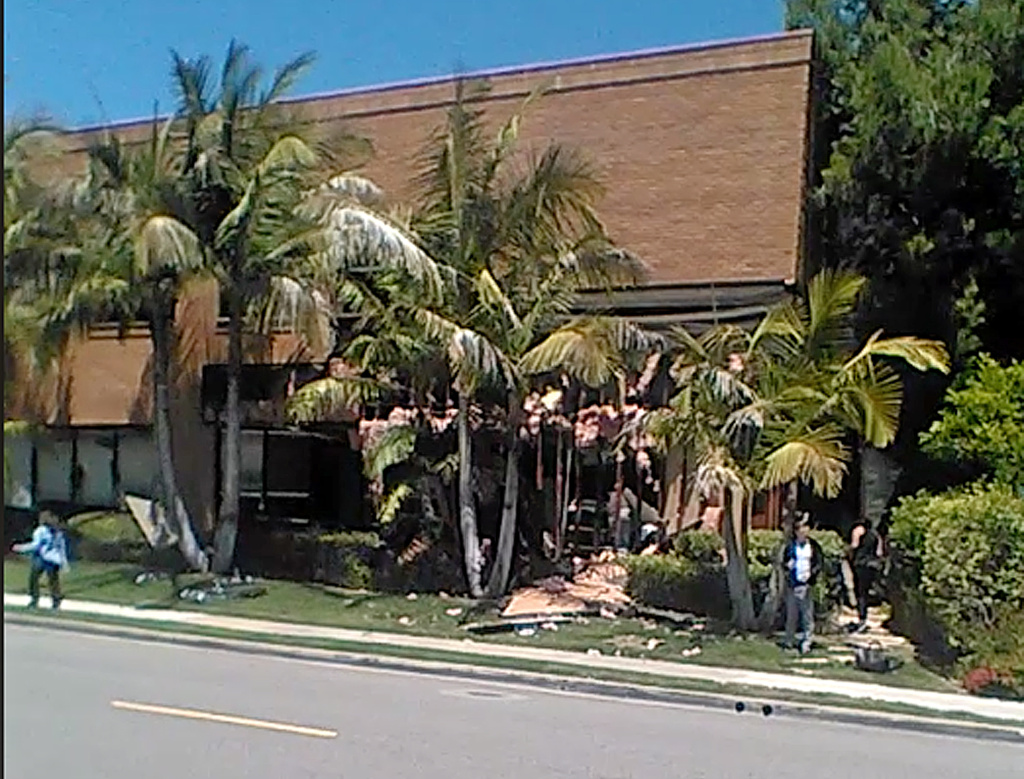 This image, taken from cellphone video, shows the medical building in Aliso Viejo, California, where a fatal explosion occurred on Tuesday, May 15, 2018.