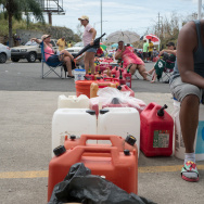 People have been waiting in line inside cars and on foot with gas canisters since before sunrise on Monday in Rio Grande, Puerto Rico.