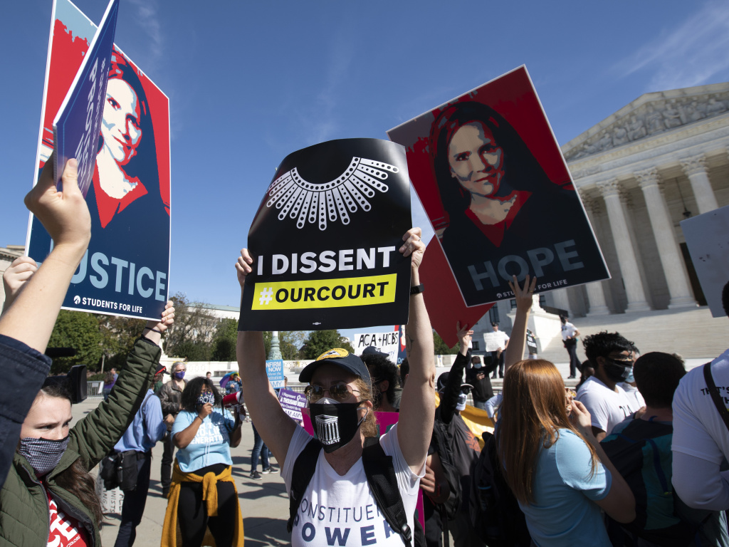 Supporters and opponents of the confirmation of Judge Amy Coney Barrett rally Wednesday at the Supreme Court. On Thursday, witnesses will speak at the Senate Judiciary Committee for and against President Trump's nominee to the court.