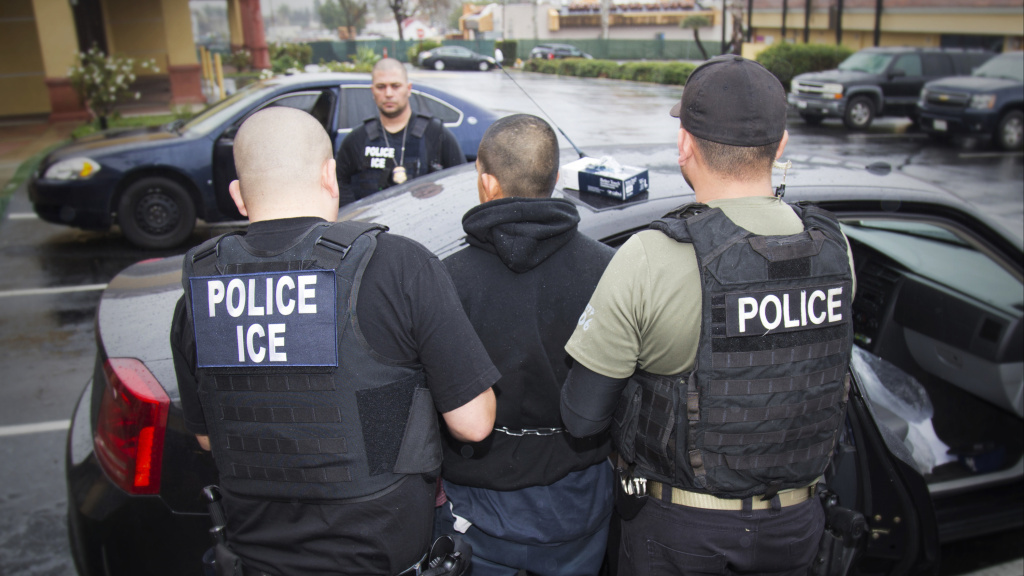 FILE: A photo released by U.S. Immigration and Customs Enforcement shows an arrest during an ICE operation.