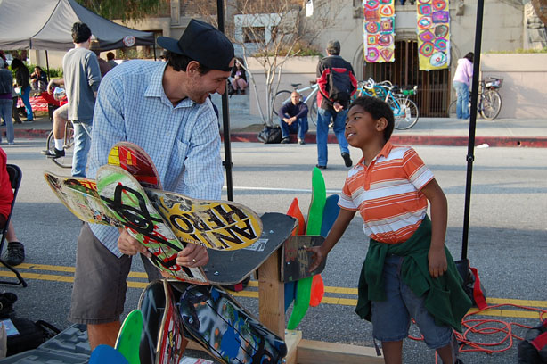 Jack Martinez, who is with theLos Angeles Arts and Athletics Alliance, builds a sculpture made of old skateboards.