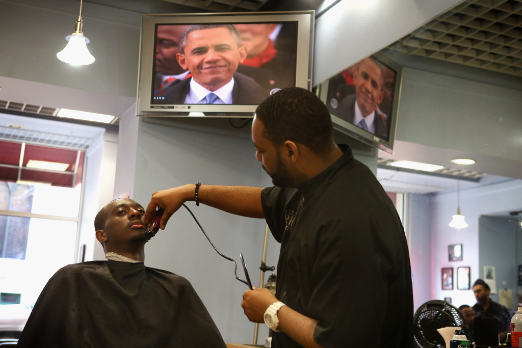 File: Daniel Williams gets a shave and haircut from Essex Jemison at the Hyde Park Hair Salon while the inaugural ceremonies  for President Barack Obama are shown on the television Jan. 21, 2013 in Chicago, Illinois.