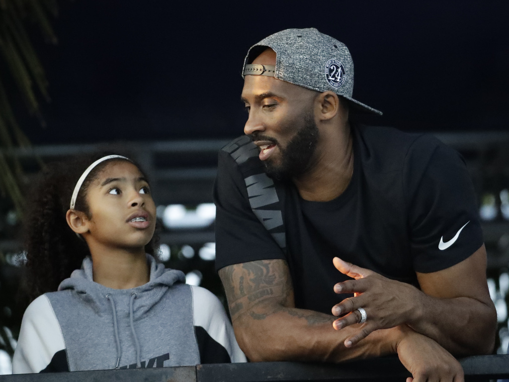 Former Los Angeles Laker Kobe Bryant and his daughter Gianna, shown here in 2018, were killed in a helicopter crash last year.