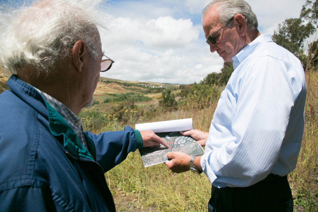 Bob Adams (left) of the Rancho San Clemente Business Park and Fred Holgate (right) of the Emergency Shelter Coalition tour a 10-acre parcel that the business park wants to donate to open a homeless shelter, May 21, 2019.