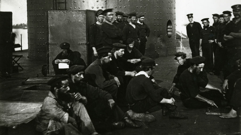 In this undated photograph provided by Naval History and Heritage Command, the crew of USS Monitor relax just outside of its turret.