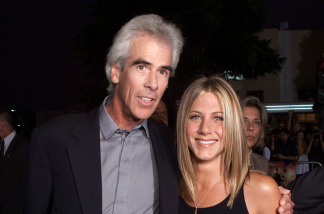 Exec. Prod. Steve Reuther and Jennifer Aniston at the premiere of 'Rock Star' at the Mann Village Theater in Los Angeles, Ca. 9/4/01.