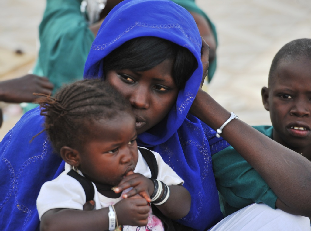 A woman sits with her daughter in Touba, a central region of Senegal.