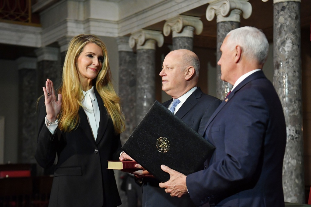Sen. Kelly Loeffler (left), R-Ga., during her ceremonial swearing in by Vice President Pence in January. Loeffler faces another Georgia Republican, Rep. Doug Collins, in a special election to complete her term, a divisive intraparty conflict that lays bare divisions within the Georgia GOP that could cost the party the seat.