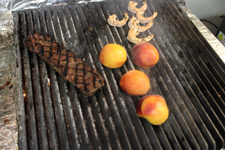 Chef Antonio David Luna took us back-of-house to the kitchen for a grilled peach salad with parmesan cheese, arugula and an apple cider vinaigrette, and grilled hangar steak.