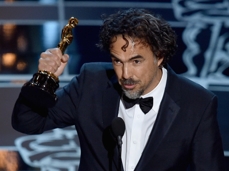 """Director Alejandro Gonzalez Inarritu accepts the Best Director Award for """"Birdman"""" onstage during the 87th Annual Academy Awards at Dolby Theatre on February 22, 2015 in Hollywood, California. The director and screenwriter dedicated his Oscar to his fellow Mexicans, including those living as immigrants in the U.S."""