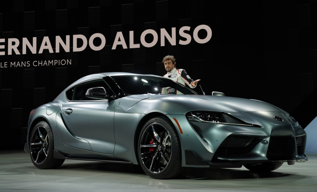 F1 driver Fernando Alonso unveils the Toyota Supra Super GT race car during day one of the 2019 North American International Auto Show January 14, 2019 at the Cobo Center in Detroit, Michigan.
