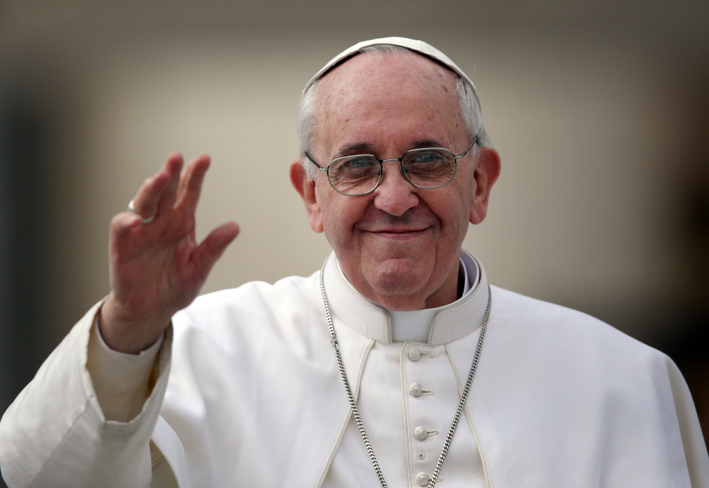 Pope Francis waves to the crowd as he drives around St Peter's Square ahead of his first weekly general audience as pope on March 27, 2013 in Vatican City, Vatican.