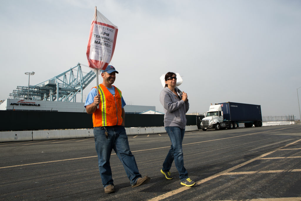 Clerical workers at the Port of Los Angeles protest outside of the APM Terminals on December 4th, 2012.