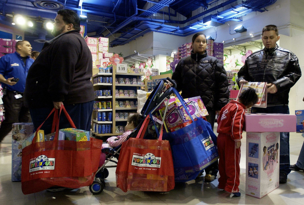 Shoppers wait to pay for their gifts at a toy store.