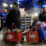 Shoppers wait to pay for their gifts at