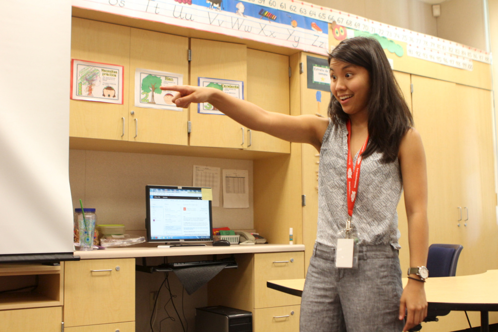 FILE: Zoe Kumagai, a new music teacher at Veterans Elementary School in Chula Vista, California, instructs a group of kindergarten students.