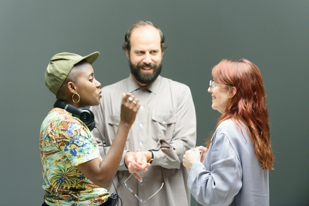 (L-R) Janicza Bravo (writer-director), Brett Gelman (writer-star) and Megan Mullally on the set of