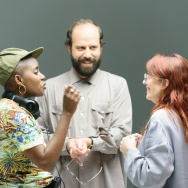 "(L-R) Janicza Bravo, Brett Gelman and Megan Mullally on the set of ""Lemon."""