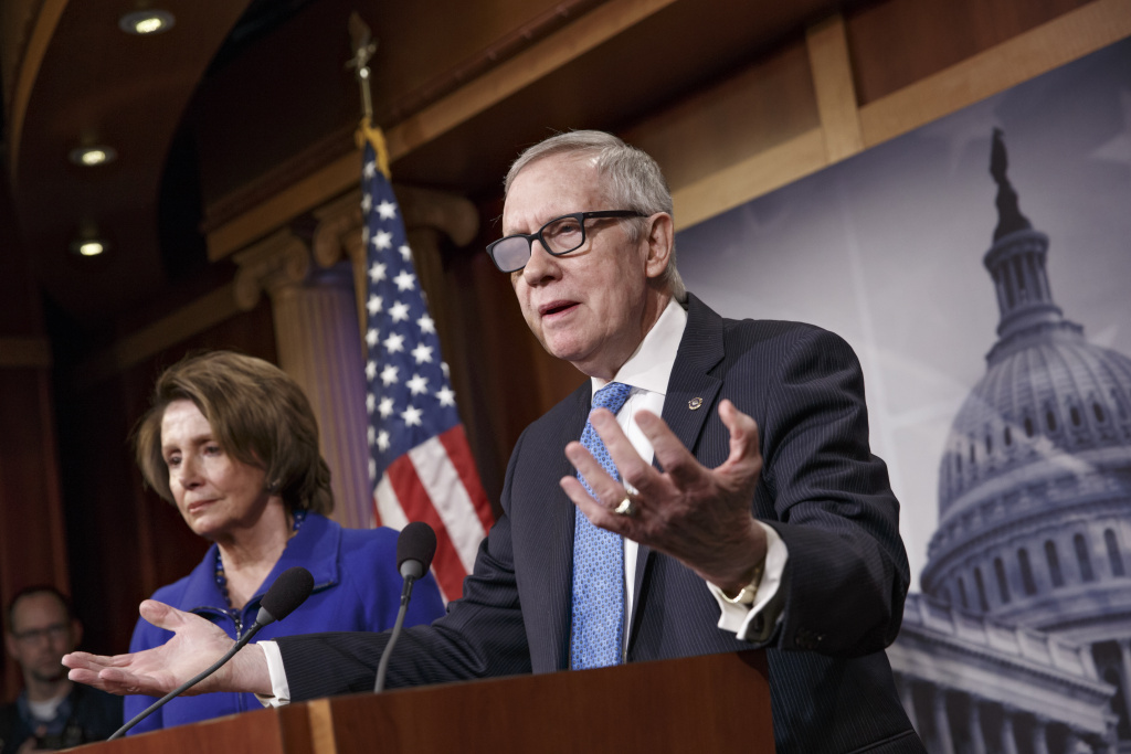 Senate Minority Leader Harry Reid of Nev., accompanied by House Minority Leader Nancy Pelosi of Calif., gestures during a news conference on Capitol Hill in Washington, Thursday, Feb. 26, 2015, talks about the impasse over passing the Homeland Security budget because of Republican efforts to block President Barack Obama's executive actions on immigration. Reid suffered injuries after a violent exercise accident in December. (AP Photo/J. Scott Applewhite)