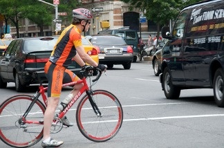 A bicyclist braving traffic.