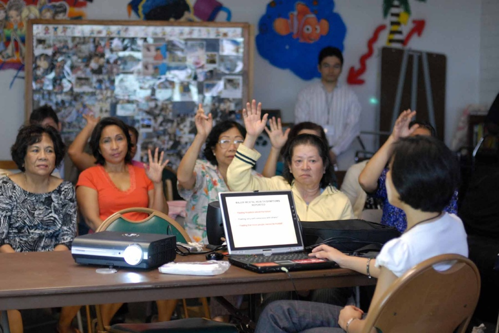 Leakhena Nou, a sociology professor at Cal State, Long Beach, guides survivors of the Khmer Rouge through how to give a written testimony in this photo taken in 2010.