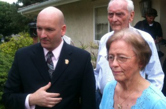 Orange County Republican Marilyn Davenport with her husband, Dick, and Orange County GOP activist Tim Whitacre (left), at a news conference in front of the Davenports' Fullerton home on April 20, 2011.