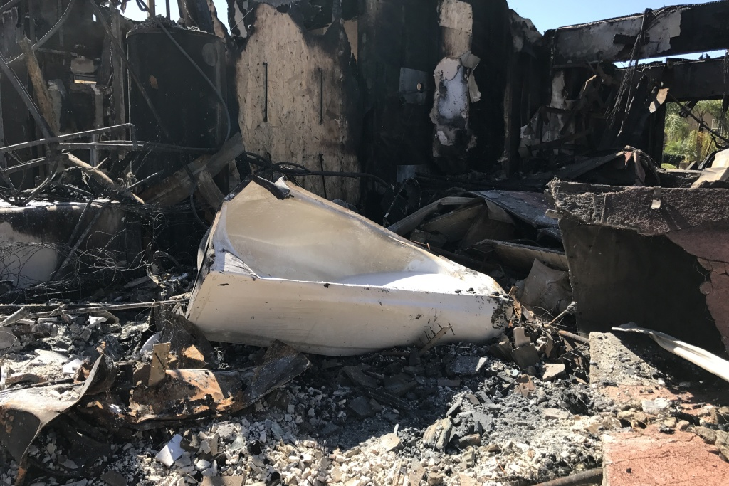 Fifteen homes were completely destroyed by the Canyon Fire 2 that raced through the Orange County hills in early October, fed by Santa Ana winds, heat and abundant, dry brush. Questions are now swirling over firefighters' initial response to the fire.
